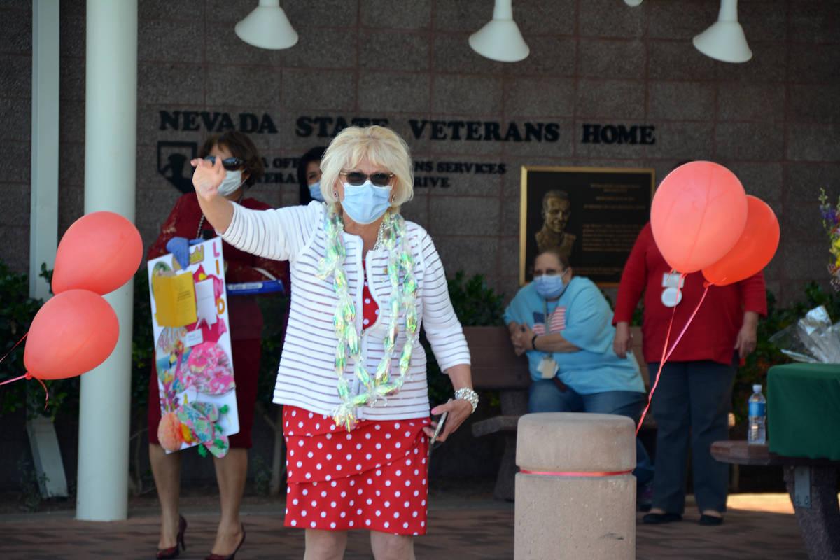 Celia Shortt Goodyear/Boulder City Review Linda Gelinger waves at a car during a retirement par ...