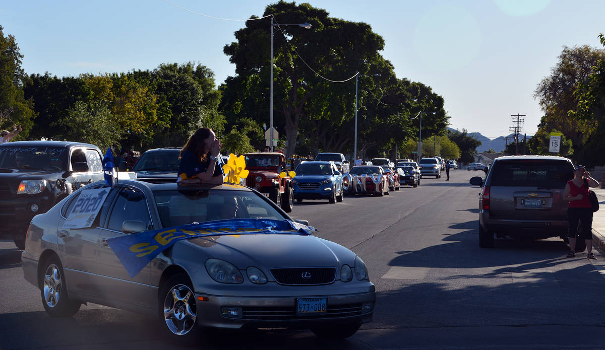 Celia Shortt Goodyear/Boulder City Review Cars and members of the class of 2020 fill Fifth Aven ...