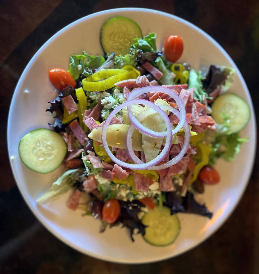 Milo's Cellar Milo's Cellar Greek salad features kalamata olives, sliced cucumber, artichokes, ...