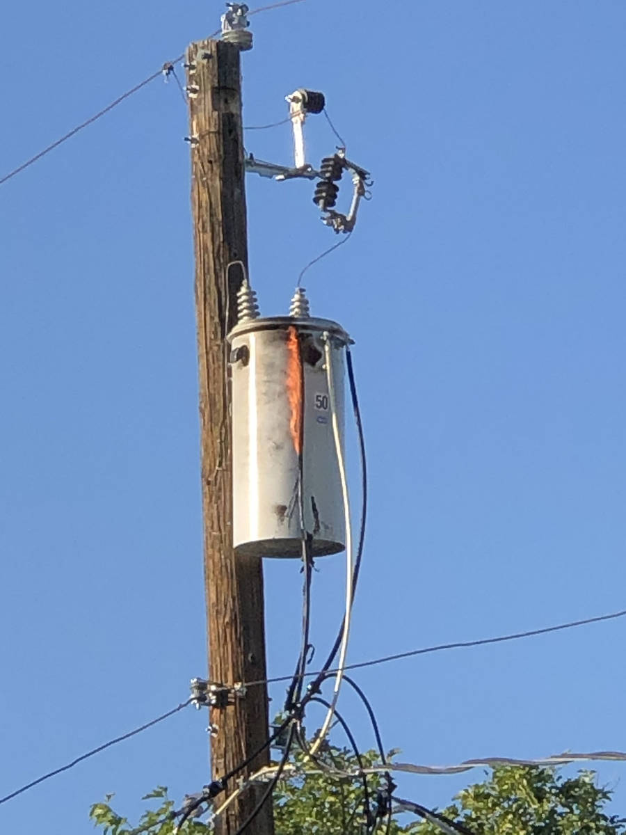 """(Norma Vally) A transformer """"can"""" caught fire on a utility pole in the alley betw ..."""