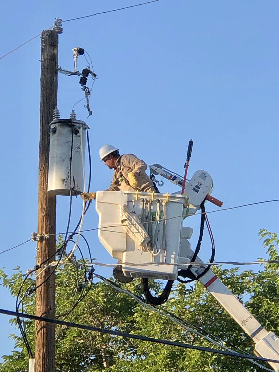 """(Norma Vally) Boulder City Utility Department repairs a transformer """"can"""" that ca ..."""