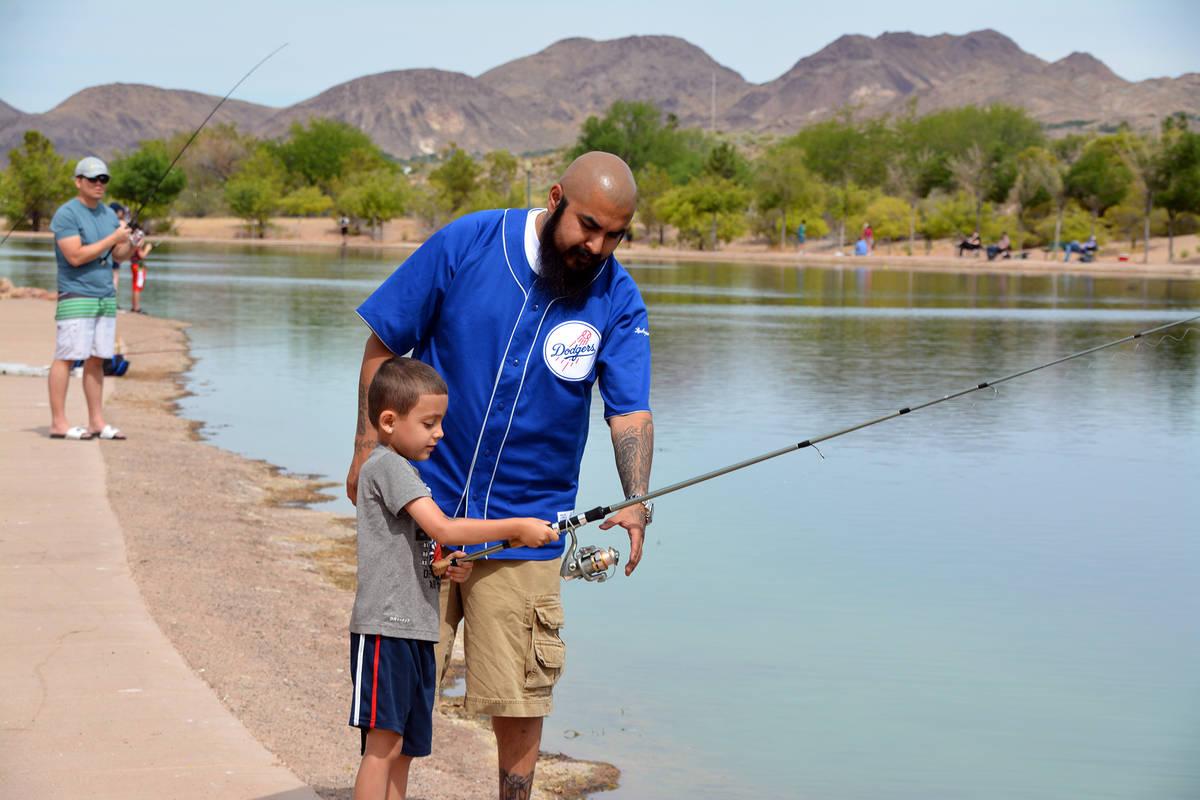 (Celia Shortt Goodyear/Boulder City Review) Juan Santos helps his son, Angel Santos, fish durin ...