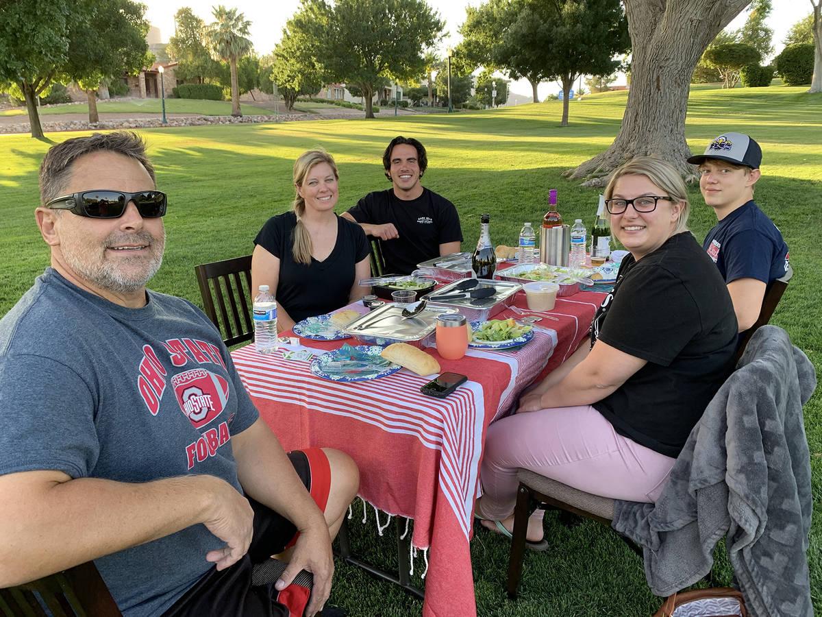 (Hali Bernstein Saylor/Boulder City Review) Enjoying an evening picnic Monday, June 29, in Wilb ...