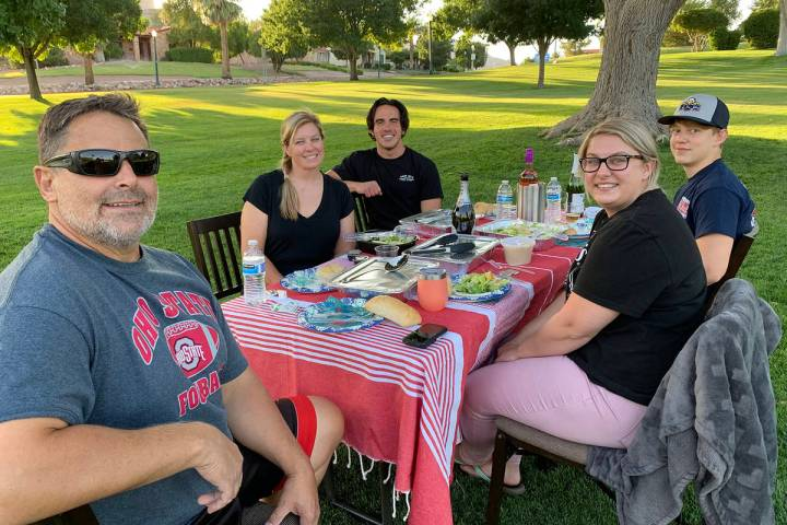 (Hali Bernstein Saylor/Boulder City Review) Enjoying an evening picnic Monday, June 29, in Wilb ...