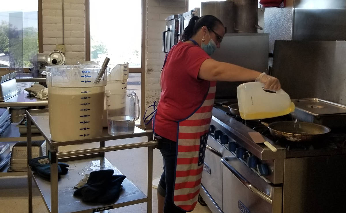 Celia Shortt Goodyear/Boulder City Review Shannon Chavez oils the griddles to make more pancake ...