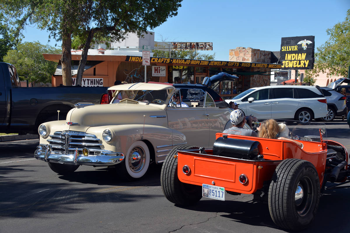 Celia Shortt Goodyear/Boulder City Review Two cars pass each other during the parade Saturday, ...
