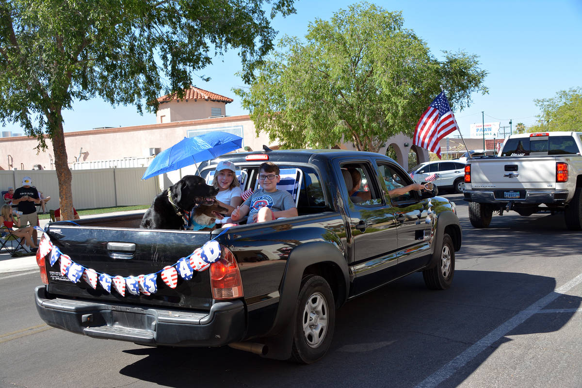 (Celia Shortt Goodyear/Boulder City Review) A family participates in the parade Saturday, July ...