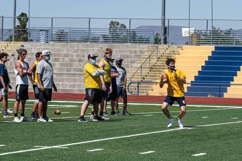 (Jamie Jane/Boulder City Review) Senior Matthew Felsenfeld, center, prepares to pass the ball T ...