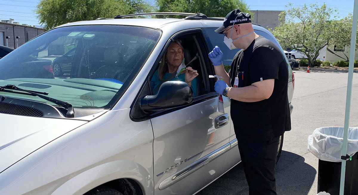 (Hali Bernstein Saylor/Boulder City Review) Anna Krone of Boulder City gets instructions from J ...