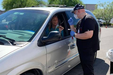 (Hali Bernstein Saylor/Boulder City Review) Anna Krone of Boulder City gets instructions from J ...