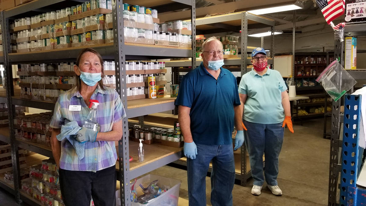 Emergency Aid of Boulder City volunteers, from left, Lori McHugh, Tom Tyler and Sue Zupanick co ...