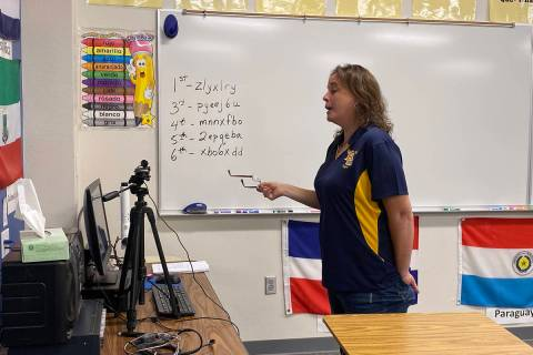 Amy Wagner Boulder City High School teacher Jennifer Marchant interacts online with her Spanish ...