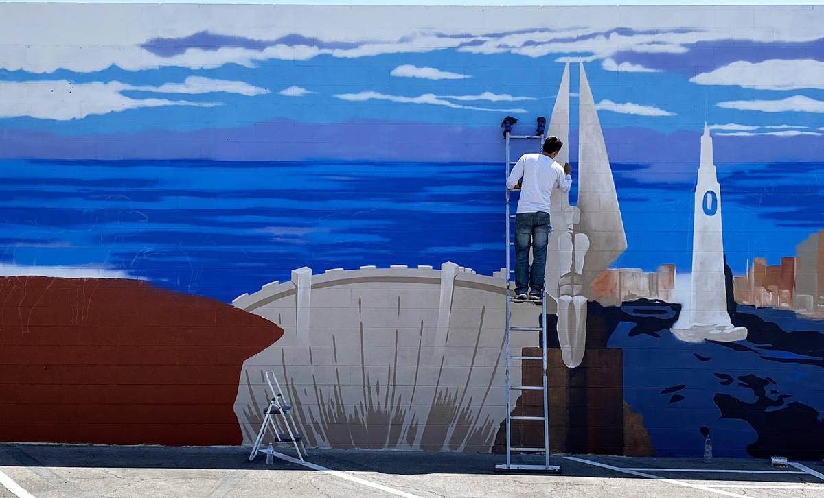Oscar Garcia Las Vegas artist Oscar Garcia works on his recent mural for the Sands Motel, 809 N ...