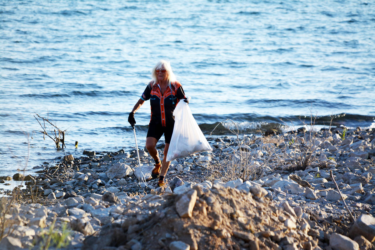 Celia Shortt Goodyear/Boulder City Review Valerie McNay picks up trash at the special events be ...