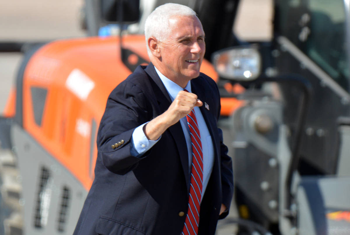 Celia Shortt Goodyear/Boulder City Review Vice President Mike Pence runs to the podium for his ...