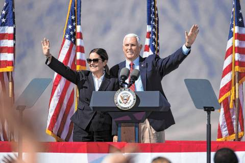 (Bizuayehu Tesfaye/Las Vegas Review-Journal) Vice President Mike Pence and his wife Karen wave ...