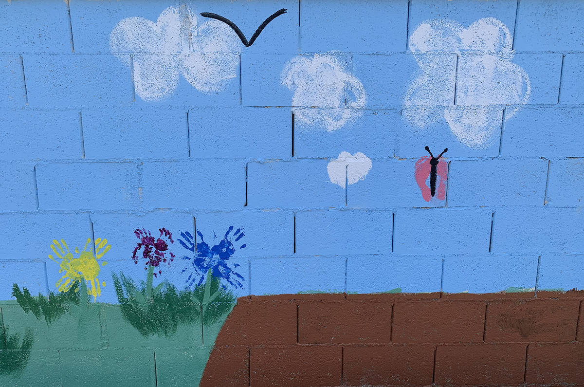 (Hali Bernstein Saylor/Boulder City Review) Hand and foot prints make up the flowers and butter ...