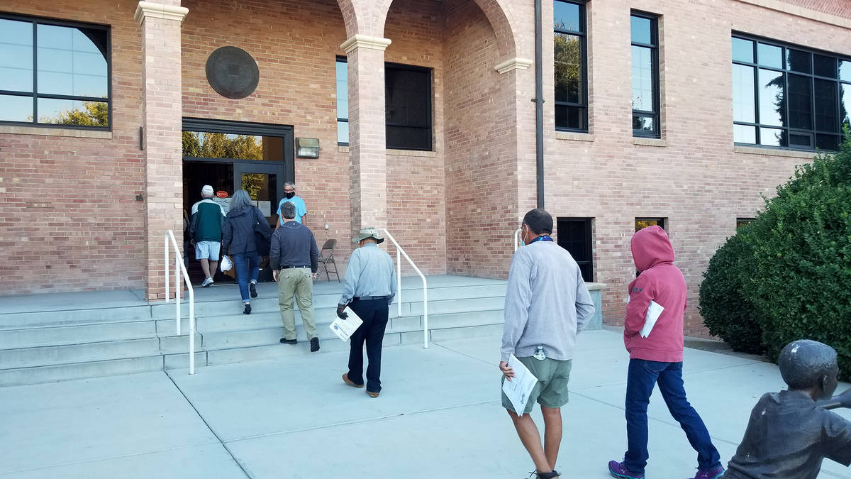 Celia Shortt Goodyear/Boulder City Review People filed into City Hall when the doors opened for ...