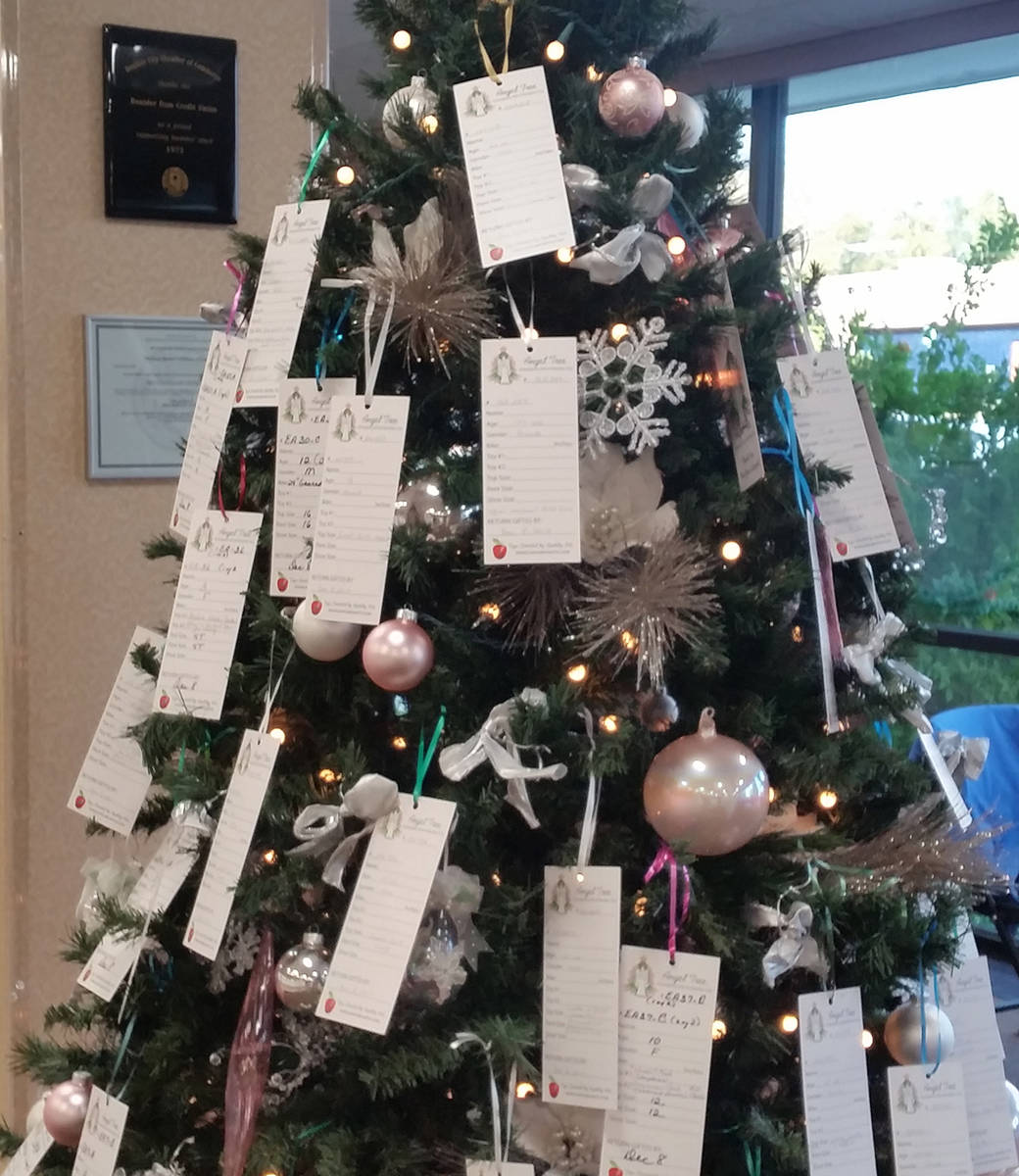 Tags with information about the needs of local children and seniors adorn the Angel Tree that w ...