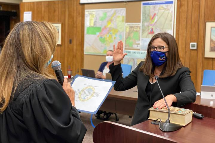 Boulder City Justice Abbi Silver, left, swears in Brittany Walker as the acting city attorney a ...