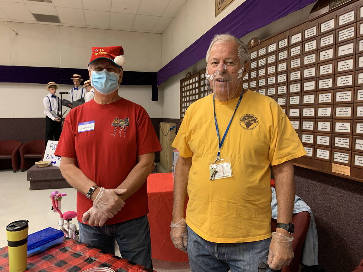 (Hali Bernstein Saylor/Boulder City Review) Chuck Barbour, left, and Jerry HcHugh welcomed peop ...