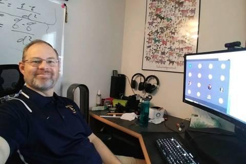Amy Wagner Boulder City High School teacher Chris Bires teaches a science class from home. Bire ...