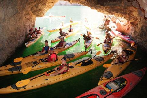 (Evolution Expeditions) Kayakers stop inside Emerald Cave during one of Evolution Expeditions&# ...