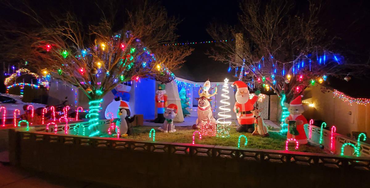 Mike Pacini Mike and Morgan Pacini's home at 653 Arrayo Way features a Christmas Yoda, Santa Cl ...