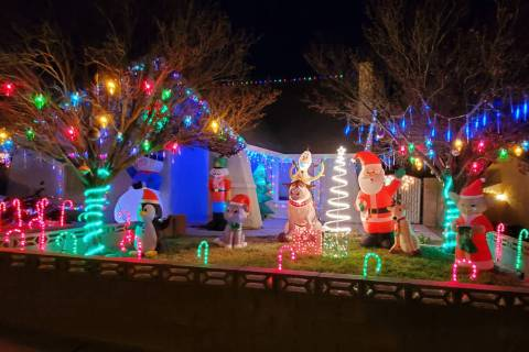 Mike Pacini Mike and Morgan Pacini's home at 653 Arrayo Way features a Christmas Yoda, Santa Cl ...