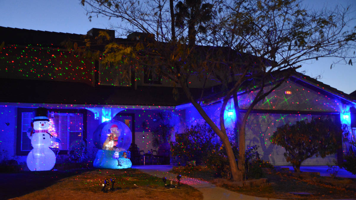 Celia Shortt Goodyear/Boulder City Review This home on Saddle Drive is accented with blue holi ...