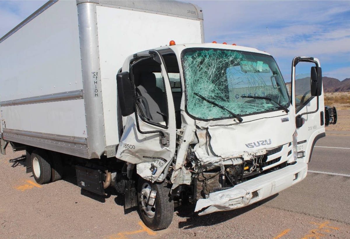 (Nevada Highway Patrol) The cab of a box truck was severly damaged after crashing into several ...