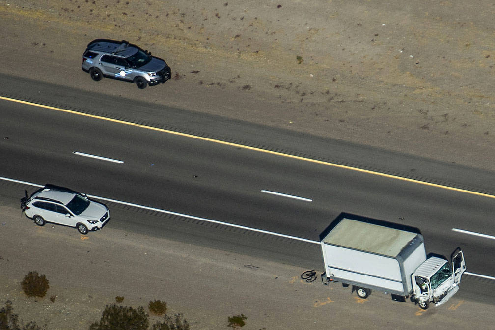 (L.E. Baskow/Las Vegas Review-Journal) A damaged box truck is pictured at the scene of a fatal ...