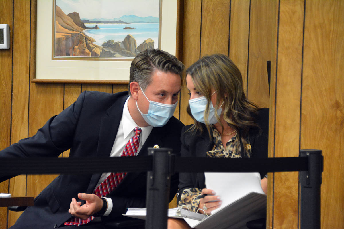 Former City Attorney Steve Morris confers with Lauren Oliver after his employment contract was ...