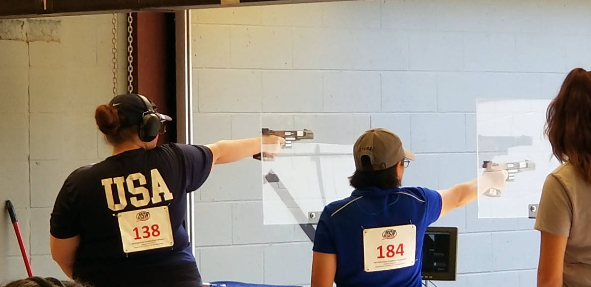 """Alexis """"Lexi"""" Lagan, left, competes in phase one of the Olympic trials for women's sport pistol ..."""