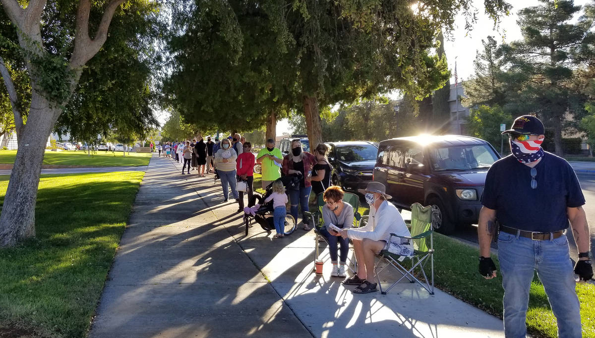 Celia Shortt Goodyear/Boulder City Review Residents lined up to cast their votes at City Hall o ...