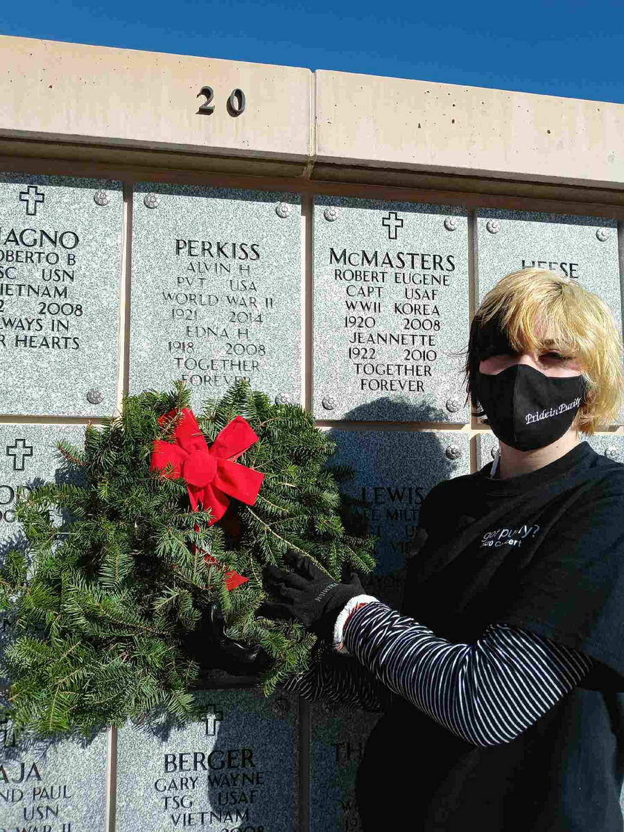 Denise Ashurst Pride in Purity volunteer Adisyn Neilson places a wreath at the final resting pl ...