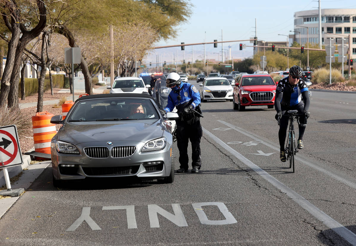 (K.M. Cannon/Las Vegas Review-Journal) Police officers, including a North Las Vegas Police offi ...