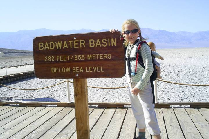 (Deborah Wall) Children should wear sunglasses when hiking in exposed areas, as this visitor is ...