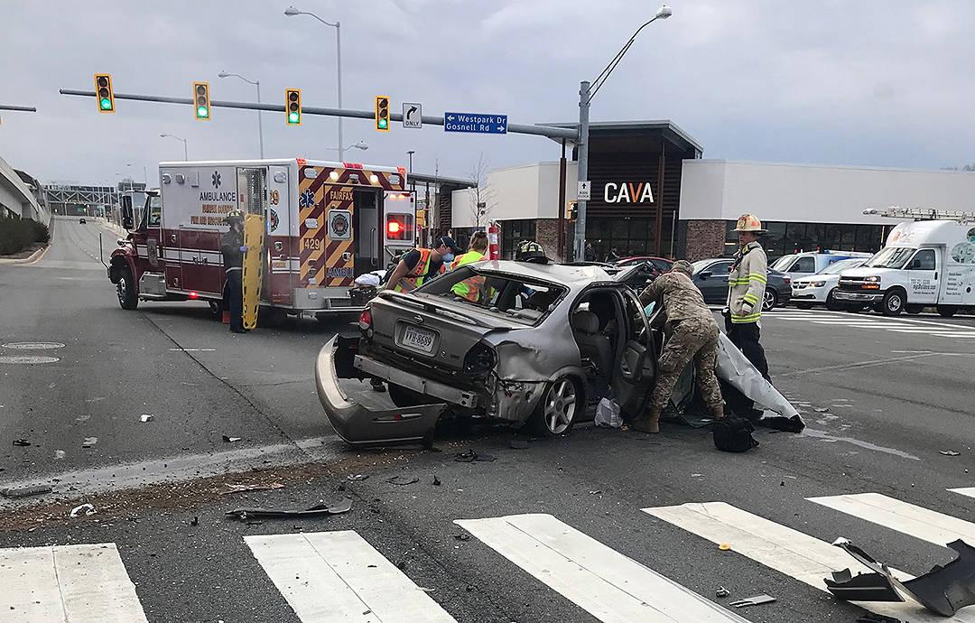 Nevada National Guard U.S. Army 1st Lt. Michael Flury helps secure an accident victim Jan. 18 i ...