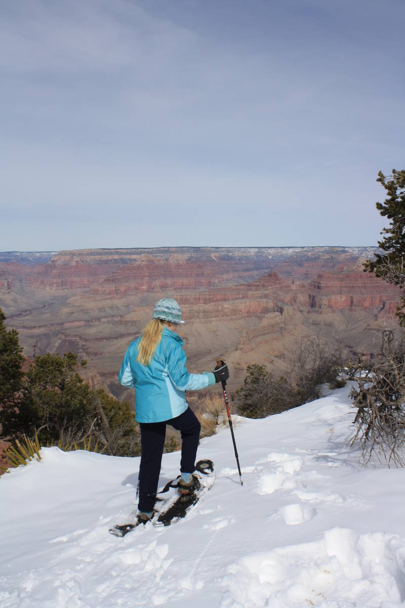 (Deborah Wall) After a big snowstorm, some visitors don snowshoes to get a closer look at the G ...