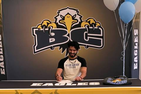 (Davis family) Trey Davis, a senior at Boulder City High School, signs his letter of intent to ...