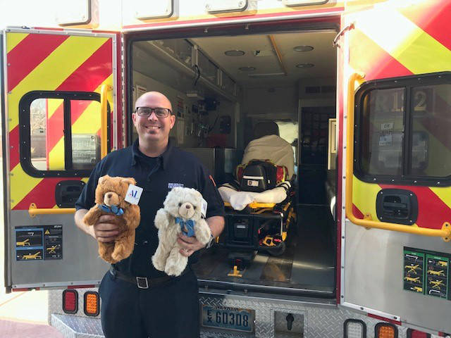 Boulder City Fire Department Boulder City firefighter Brian Shea holds teddy bears that are gi ...