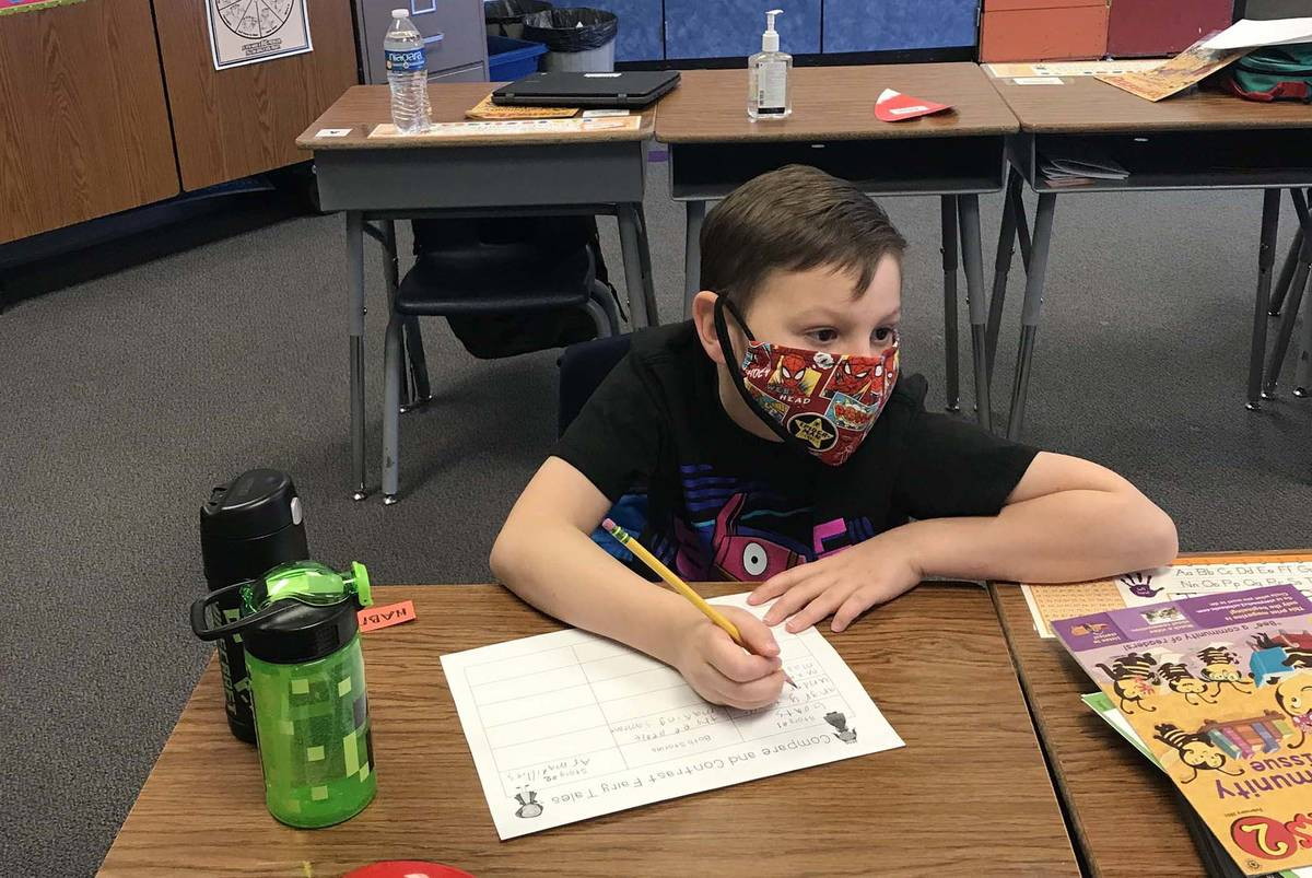 Benjamin Day Mitchell Elementary School second-grader Ty Quinlan is one of many Clark County Sc ...
