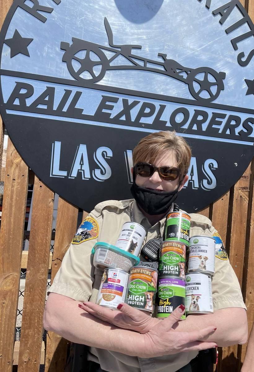 (Rail Explorers) Ann Inabnitt, supervisor of the Boulder City Animal Shelter, gathers up the fi ...