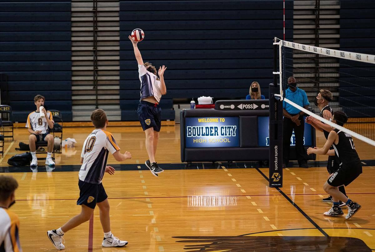 (Jamie Jane/Boulder City Review) Boulder City High School senior Toby Schaper reaches for the b ...