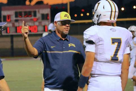 Boulder City head coach Chris Morelli, seen in 2017 talking to the team's quarterback, is seeki ...