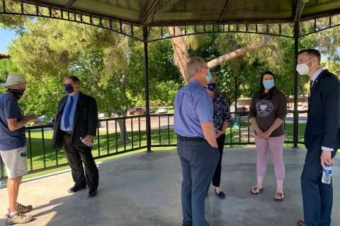 (Hali Bernstein Saylor/Boulder City Review) Resident Charlie Hauntz, from left, visits with cit ...