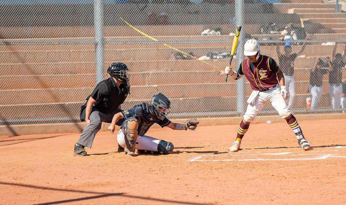 (Jamie Jane/Boulder City Review) Kenon Welbourne makes the catch at home plate in the Eagles' ...