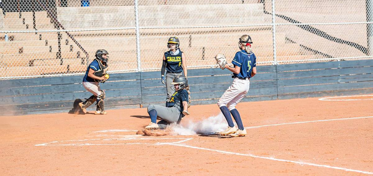 (Jamie Jane/Boulder City Review) Haley Hoover is safe as she slides into home during the Lady E ...