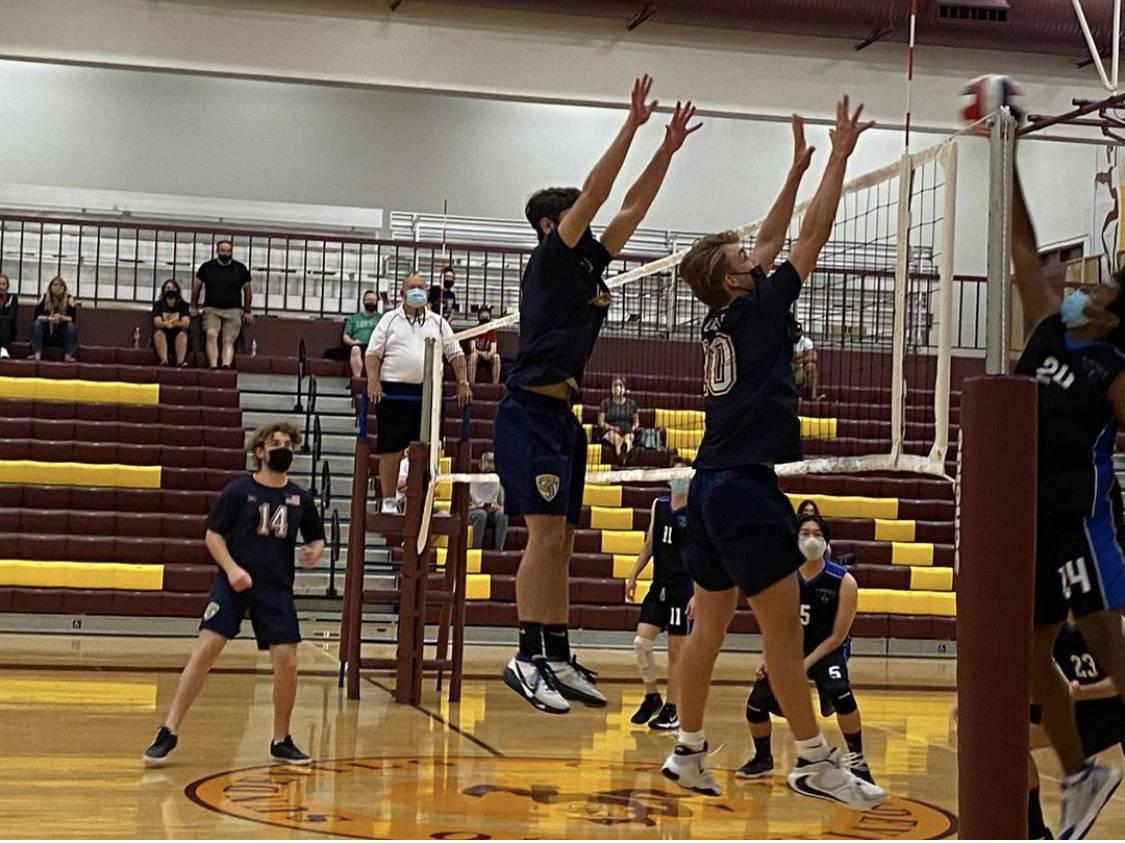 (Amy Wagner) Boulder City High School junior Kenny Rose and sophomore Tyler Lemmel go up for a ...